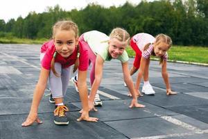 girls starting to run on track photo