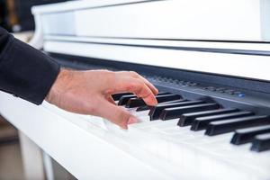 Musicians hand playing the piano photo