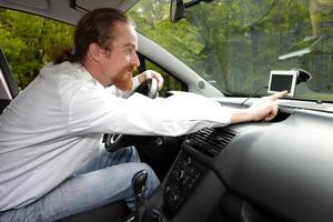 Driver using  GPS navigation a way