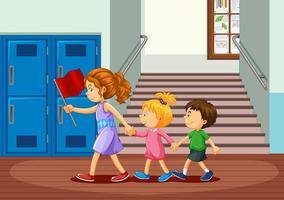 Happy children in school hallway