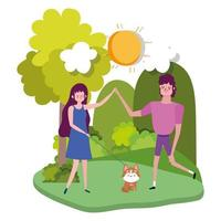 Young couple walking their dog at the park