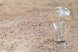 Light bulb in the sand