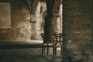 London, England, 2020 - Wooden chairs in a crypt