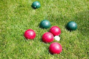 Croquet balls in the sunny grass