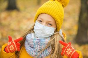 Girl wearing face mask and winter clothes