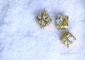 Top view of gold presents in snow