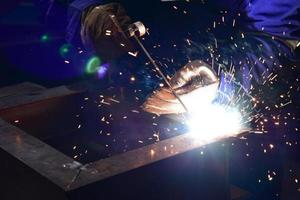 Welder in blue uniform