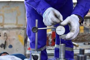 Technician using a dial gauge