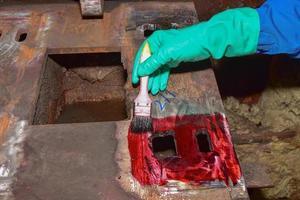 Welder applying penetrant photo