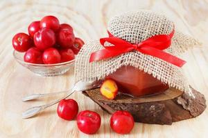 Jam, confiture of Malpighia glabra (red acerola) in jar photo