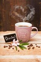 Becher Kaffee mit dampfendem Herz photo