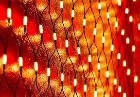 Christmas lights on dark red wall