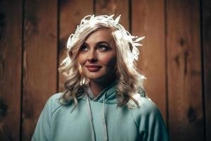 woman wearing christmas lights on head