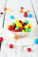 Candies on white wooden background photo