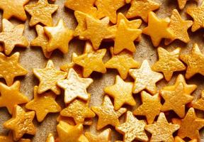 Colorful sweet background with gold star sprinkles