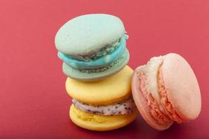 Sweet and colorful French macaroons on pastel background photo