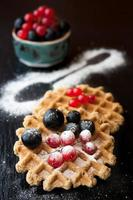 Waffles with berries. Delicious breakfast