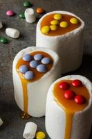 white marshmallow and caramel colored candies