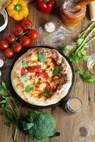 Home made margarita pizza on table photo