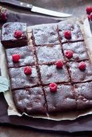 Chocolate brownies with raspberries photo