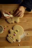 child hand make gingerbread man