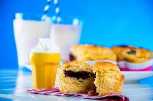 Delicious homemade muffins on blue background photo