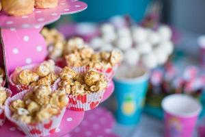 Portion popcorn on kid's party on sweet dessert table