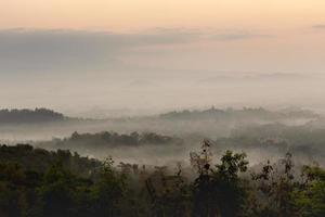 Colorful sunrise over Merapi volcano and Borobudur temple in mis