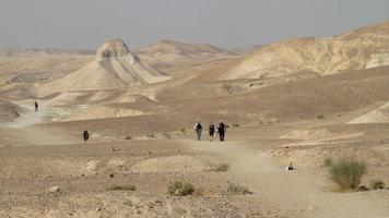 people steps across the Judean desert
