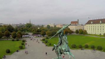 Vienna aerial city shot horse rider on Hero's square Heldenplatz. Beautiful aerial shot above Europe, culture and landscapes, camera pan dolly in the air. Drone flying above European land. Traveling sightseeing, tourist views of Austria.