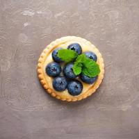 Tartlet filled with lime curd and blueberries photo