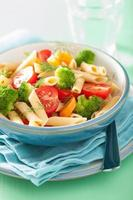 veggie penne pasta with broccoli tomato carrot photo