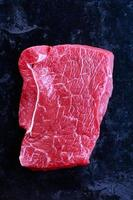 Raw beef on a black background