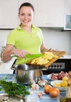 Woman cooking soup with meat photo