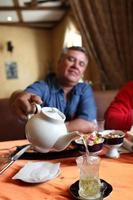 Man pours green tea