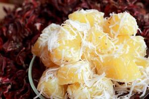 Thailand sweets - candy, boiled potatoes sprinkled with coconut.