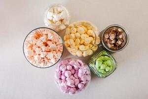 Marshmallow and meringue at white table photo