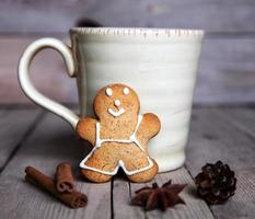 Christmas homemade gingerbread man on wooden background. Large c