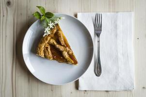 Homemade apricot jam tart with jasmine photo
