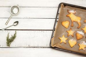 Christmas cookies on baking tray - background with text space photo