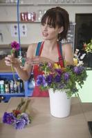Florist Arranging Flower In Shop