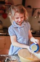 Pretty little girl baking photo