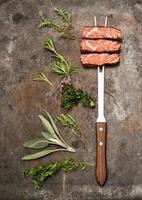 Grilled beef meat herbs spices on kitchen desk. Food background
