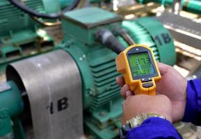 Person using infrared thermometer photo