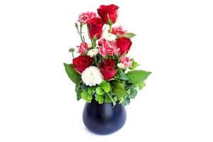 Vase of roses on white background