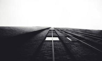 Black and white shot looking up at apartment building