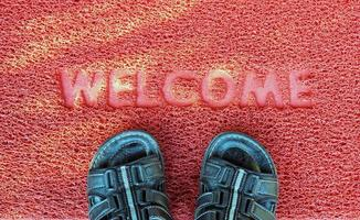 Welcome carpet with footwear