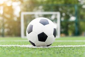 Soccer ball in the center of a playing field photo