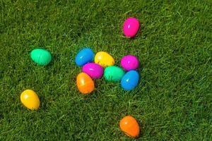 Plastic easter eggs on grass