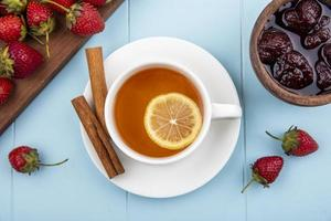 Food photography flat lay of tea and fresh fruit with copy space